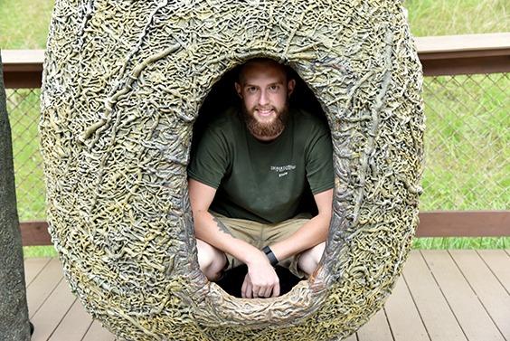 zoo keeper in nest statue