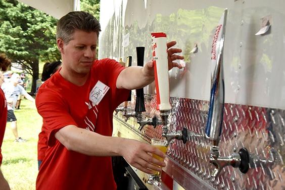 volunteer pouring beer
