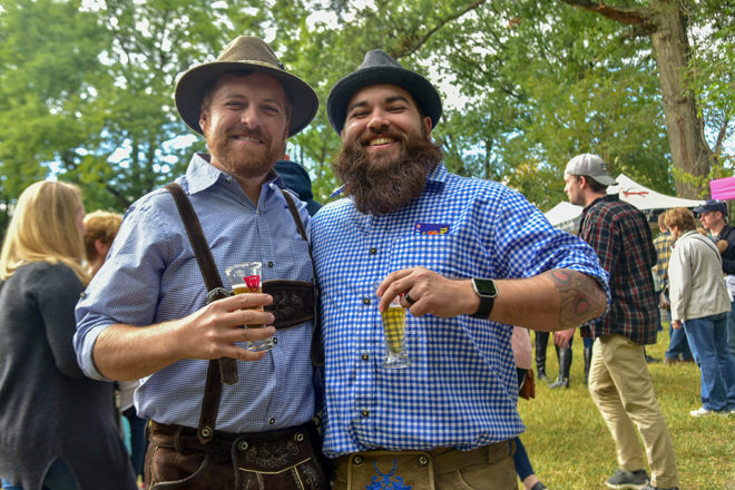 men dressed in german garb holding beer