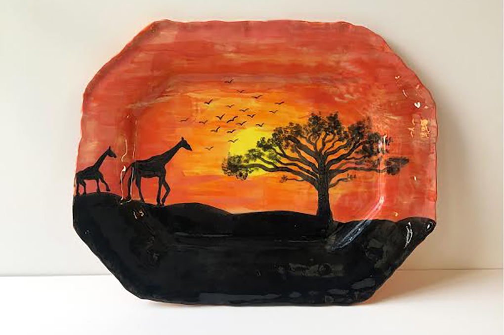 painted ceramic platter with giraffes
