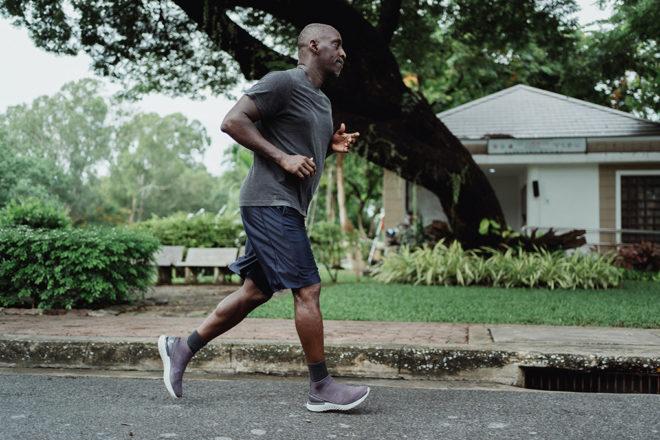man running in a neighborhood