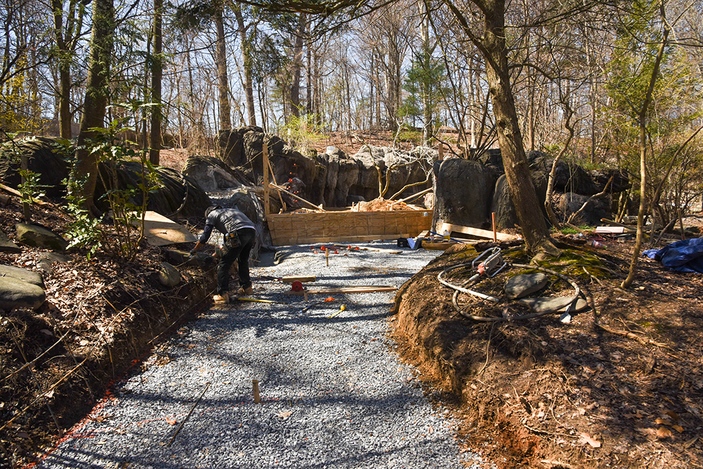 Otter habitat path construction, lined with stone.